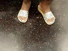 Mature ebony feet on train