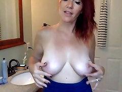 Mature redhead has great tits