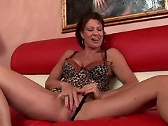 Mature brunette with big knockers fingers her shaved cunt
