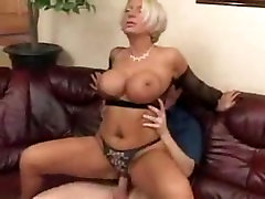 Big boobs in fishnet getting fucked