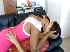 Tall black girl deep kissing whilte little girl
