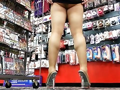 PANTYHOSE ass, leg and squatting upskirt tease in my favorite porn shop!