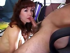Sultry talented redhead gives an awesome blowjob before getting fucked