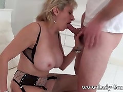 Lady Sonia abused by masked guy - blowjob and cum on tits