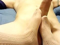 Footjob in tan nylons with cumshot!