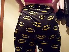 She pulls up her tight batman leggings.