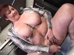 Giant breasted mature milf playing in her kitchen