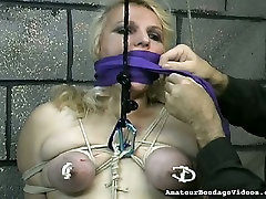 Obese slut with tied up boobs is punished in the wife brunette son room