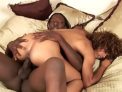 Curly appetizing chocolate babe enjoys riding fat monster black dick