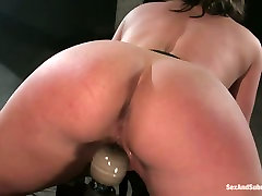 Well stacked bombshell Claire Dames is belted and fucked in bdsm room