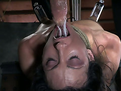 Attached to the wooden table Wenona is treated in tough ovia sex videos way