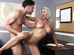 Busty blond harlot Emma Starr gets her twat fucked on the boss table