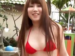 Slender Asian angel Mio Katsuragi exposes herself wearing red bikini