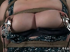 Chubby blond MILF gets her shaved cunt teased with vibrator in BDSM sex scene