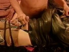CBT Electro stim to balls while dude is totally restrained in leather.