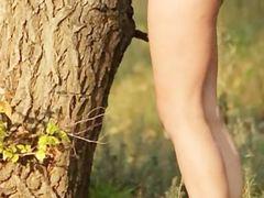Brunette hot woman teasing on the swing