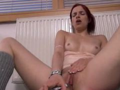 Amazing redhead dildoing her cunt