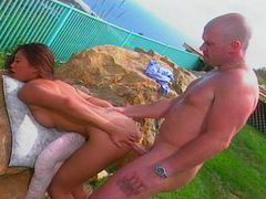 Asian chick works with both holes