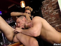 Black guys sharing the bartender at a pub