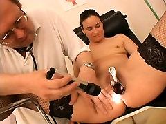 Slender brunette in black stockings offers her doctor a great blowjob