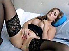 Beautiful woman in black stockings masturbates lustfully