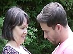 Big tits mature with young boy in public place