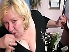 Old bitch takes two cocks at once