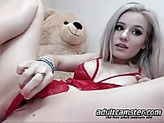 Hot young blonde girl dildoing