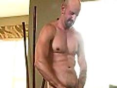 Solo hunk masturbating before cumming