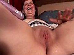 Mature redhead dildo nailing her pussy