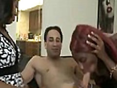 Ebony MILF shows daughter how to please a man orally