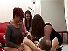 Group of femdoms tug cock