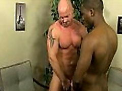Ebony stud getting fucked by a mature hunk
