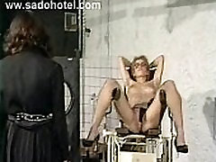 Slave gets her tits nipples and pussy lips covered with clamps by horny dominatrix