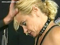 Blond milf slave with bit tits bends over and got spanked on her well formed butt