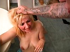 Blond mature lady d in own kitchen