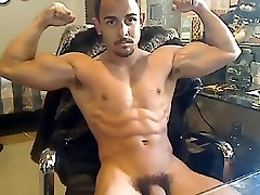 Juicy male is beating off in the apartment and shooting himself on web cam