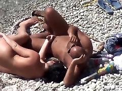 Voyeur. Mature woman have sex with a man at a public beach