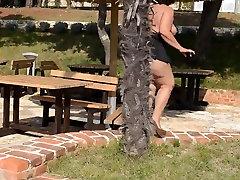 Mature Lady Naked Big Ass in Miniskirt Outdoors