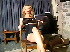 Mature blonde with big tits strips to show her body