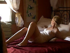 Mature babe rubs her experienced pussy