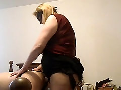 Sexy BBW MILF fucking a man with a huge strap on