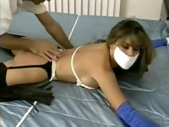 Women tied on bed and tape gagged