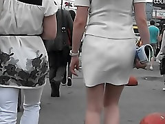 Coquette wearing a nice white skirt and gets voyeured