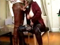 Blonde mature with glasses blowing a firm cock