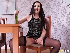 Brunette white hottie in sexy black lingerie flashes her pussy on the chair