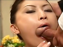 Japanese mistresse in white on her knees engulfing weenie