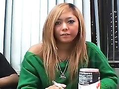 Striking Asian girl in pink panties has a guy taking care o