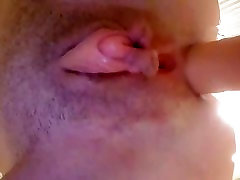 big clit while dildoing her asshole