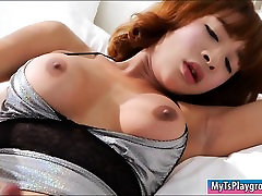 Big boobs redhead shemale masturbates her cock on the bed